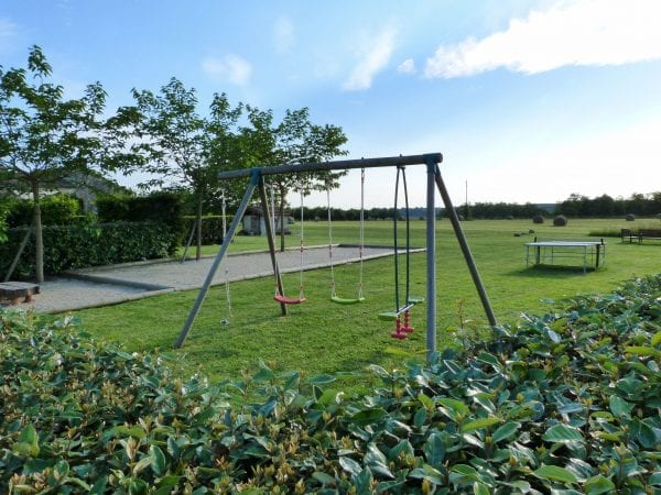 Facilities include childrens swings, petanque court, dart board, football nets and table tennis