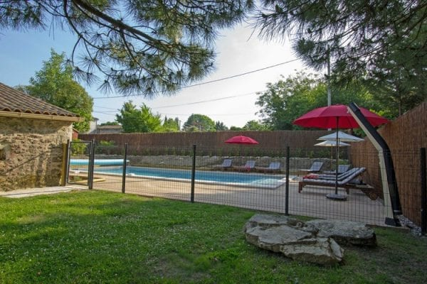 Fenced and gated pool, secured by a lock with a key, the pool also has an alarm