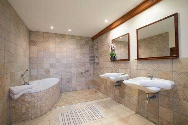 Ground floor bathroom and shower wet room with wc shared with bedrooms 2 and 3