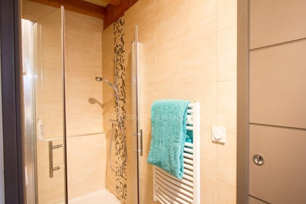 Ground floor shared shower room has two doors which lead into bedrooms 3 and 4