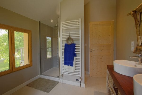 The upper floor bathroom with walk in shower