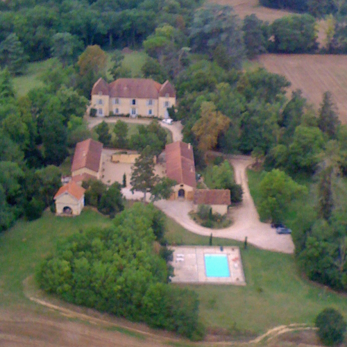 Aerial view of the 2 properties and the owners house