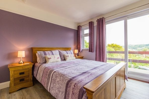 Bedroom 1 with views down to Combe Martin and the beach
