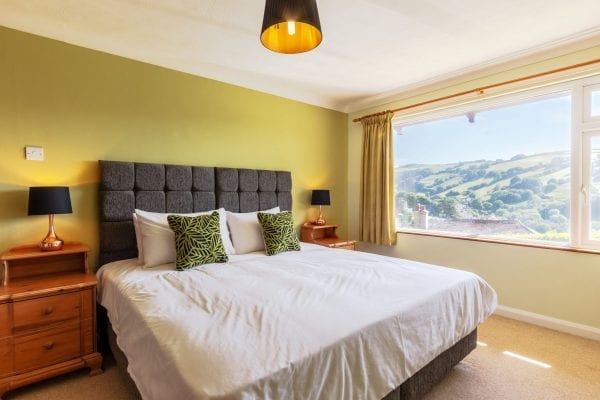 Bedroom 2 twin or large double bed, sea view and and a walk in shower