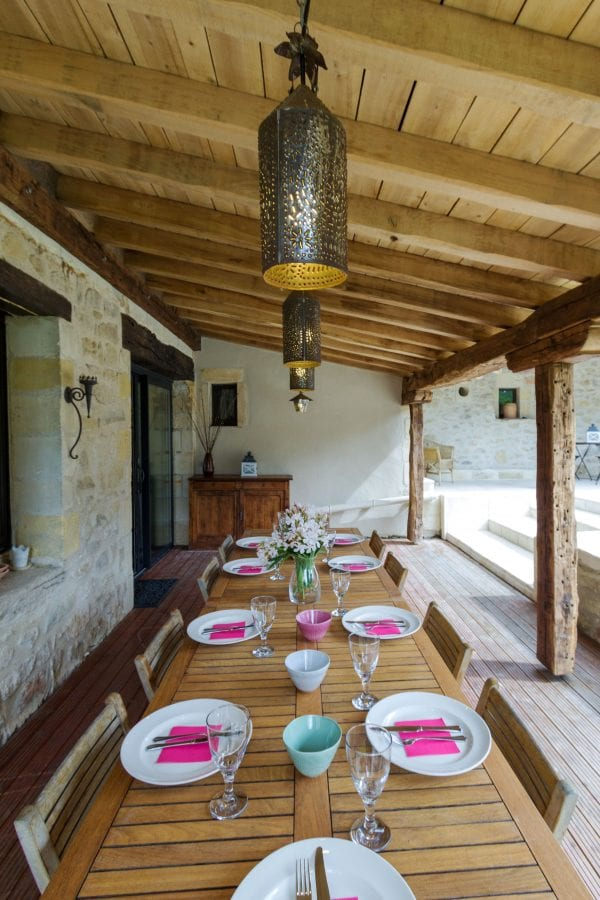 Dining on the covered rear terrace