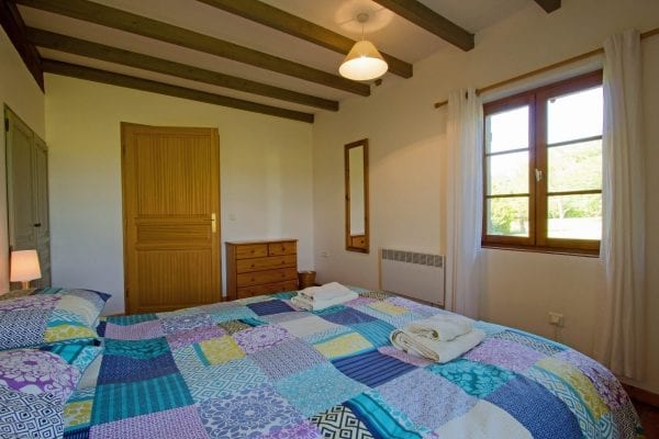 Double bedroom with views over fields and the garden