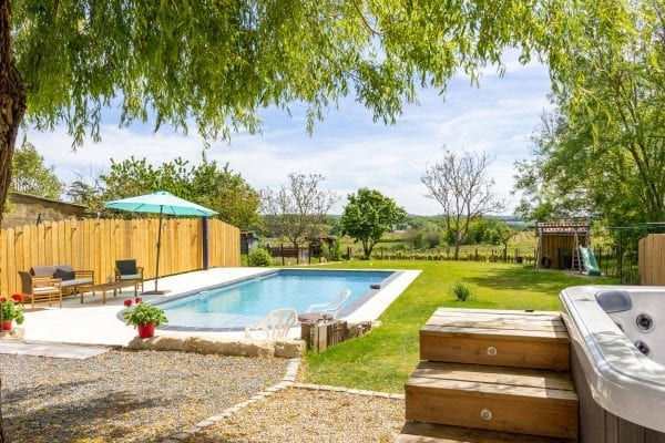 Large hot tub and a private heated pool with vineyard views