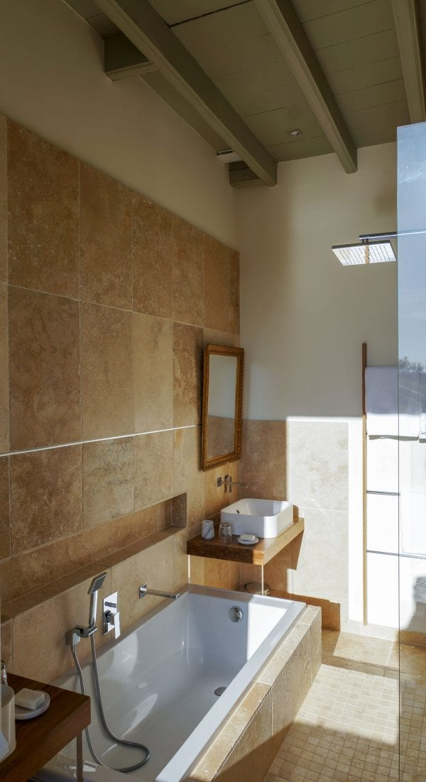 Master bedroom with a walk in shower and a bath