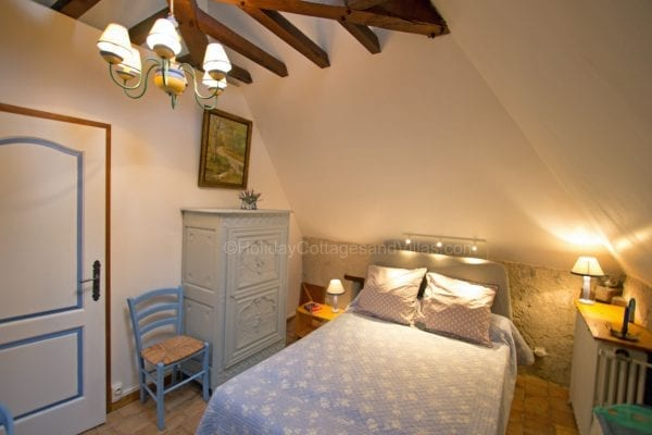 Le Four one bedroom cottage upper floor double room, the door leads into the shower room and wc