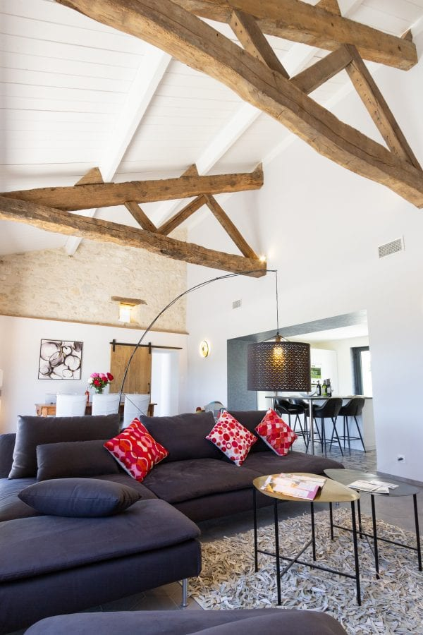 Open plan living space with double height ceilings