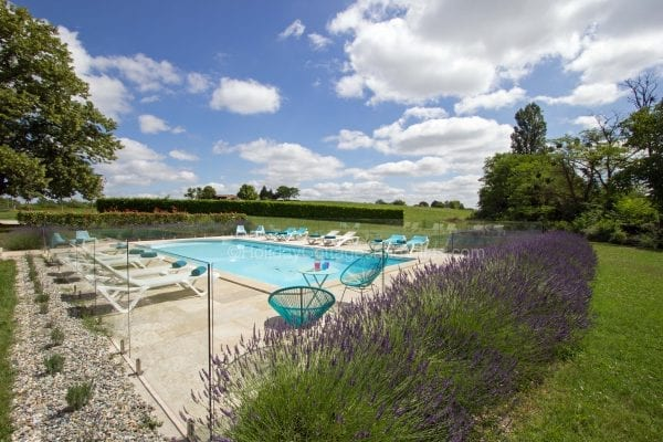 Private secure fenced and gated luxury heated pool surrounded by a sun terrace with views