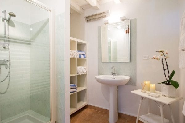 Shower room shared with bedrooms 2 and 3, next to a separate wc