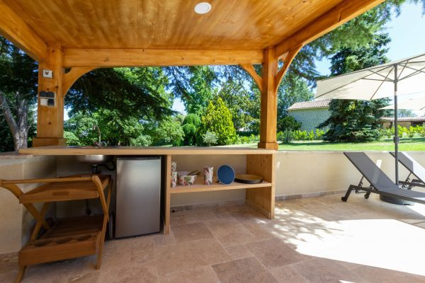 Simple summer kitchen area by the pool