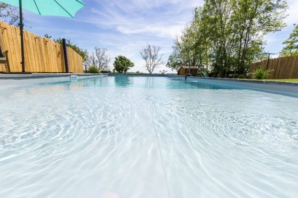There is a large gently shallow shelf within the pool then steps within the pool