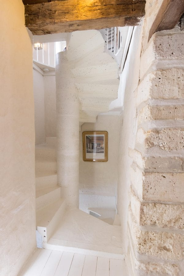 To the left is bathroom 1, the spiral staircase leads up to bedroom 3 and down to the ground floor by shower room 3