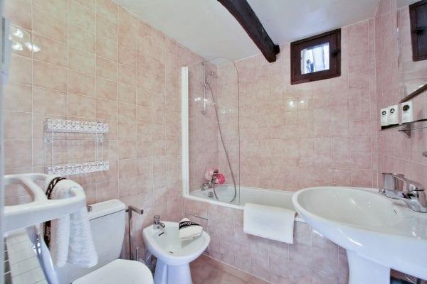 Bathroom with an in bath shower